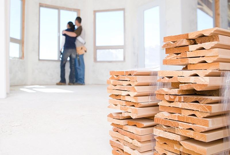 couple standing in a new construction home