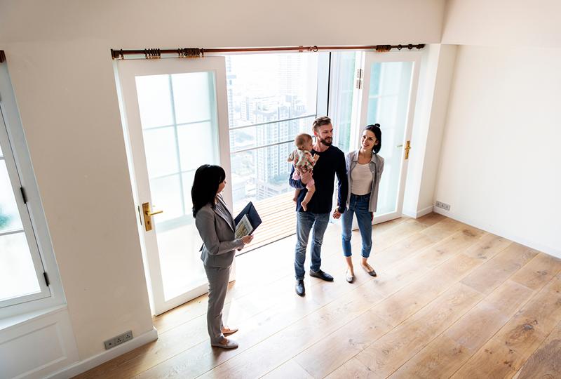 First-time condo buyers walking through a condo